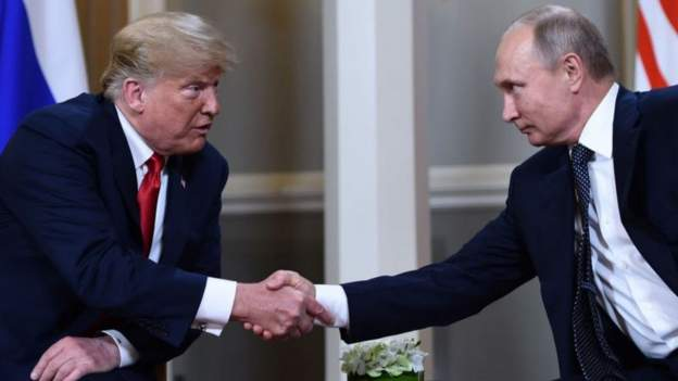 Putin silent, but Russian anchor calls US system 'a dinosaur'